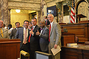 """6/28/2020 Jackson MS. <br />  Pictured is a group of MS Senators responsible for passing the new MS Flag Bill including David Blount (D) far right.  supporters and Black lives Matter advocates. The Black Lives Matter advocate had a hand made sign that read """" Welcome to the Right side of History Mississippi"""" .  Confederate symbol on the morning of the historic legislator vote. The Mississippi State legislators gathered at the State Capitol Sunday for a historic vote on HB1796. The MS House of Representatives  passed the Bill91-23 and the MS Senate voted 31-14 in favor of changing the flag. The Bill would allow for the redesign of the Mississippi State Flag, the current flag has the Confederate symbol on it. Mississippi is the last State in the Nation to still have the racist Confederate symbol on its state flag. Black Lives Matter advocates celebrated the historic vote outside the Capitol. The Mississippi House of Representatives passed the Bill and so did the Mississippi Senate, Governor Tate Reeves said he would sign it if it passed. Photo © Suzi Altman"""