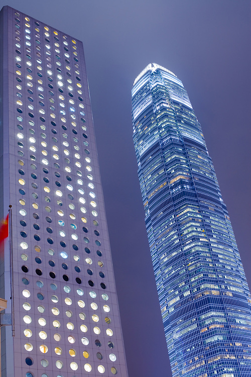 Chung Wan (Central district), Hong Kong Island, Hong Kong, China, Asia - View of iconic skyscrapers Jardine House, locally known as the House of a Thousand Orifices at the left and International Finance Centre 2 at the right.
