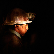 A bolivian miner chew coca leaf during the long day work inside Cerro Rico's silver mines in Potosi, Bolivia.