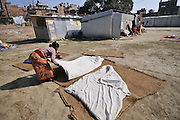 Dec. 29, 2015 - Kathmandu, NP, Nepal -<br /> <br /> Earthquake Survivors struggling in temporary Tent on Winter Season<br /> <br /> ASTA MAYA MAHARJAN, 75yrs, an earthquake survivor puts Woolen quilt on sun to make warm for the winter season protection for sleeping on her temporary tent on 29 December, 2015 at Panga, Kirtipur, Kathmandu, Nepal. Most of houses in Panga, Kirtipur were destroyed by recent earthquake on April 25, 2015, a magnitude of 7.8 earthquake killing over 8,000 of people in Nepal and thousands of injured, which Outcomes Hundreds of people were homeless with entire villages across many districts of the country. <br /> ©Exclusivepix Media