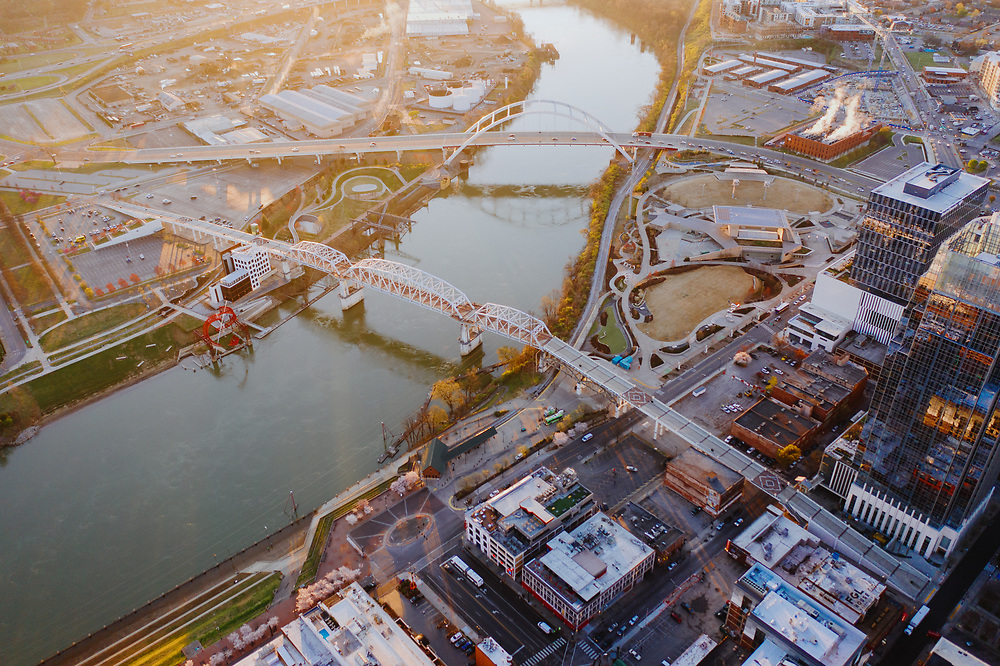 Aerial view of the Cumberland River flowing past Nashville, Tennessee at the sun rises.