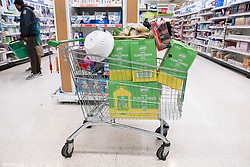 © Licensed to London News Pictures. 03/03/2020. London, UK. A supermarket trolly loaded with cooking oil in a Asda supermarket in Wembley as more Coronavirus disease cases are reported in the the UK. Photo credit: London News Pictures