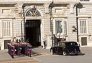 Soldiers in traditional dress uniform greet royal  car, Palacio Real royal palace, Madrid, Spain