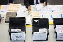 May 5, 2017 - Birmingham, West Mids, UK - Birmingham, UK. Birmingham Mayor Election results held at the Barclaycardarena, Birmingham. Pictured, counting boxes for second round between ANDY STREET and SION SIMON. (Credit Image: © Dave Warren/London News Pictures via ZUMA Wire)