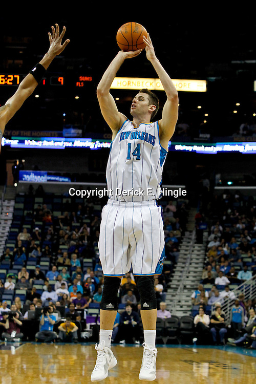 February 2, 2012; New Orleans, LA, USA; New Orleans Hornets power forward Jason Smith (14) shoots against the Phoenix Suns during the first quarter of a game at the New Orleans Arena.   Mandatory Credit: Derick E. Hingle-US PRESSWIRE