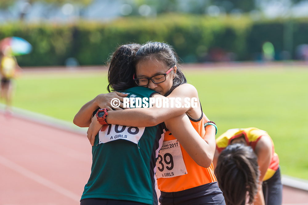 Celeste Goh (#39) of Singapore Sports School and Clenyce Tan (#108) of Raffles Institution share a moment after the race. Clenyce (#108) managed to clinch the silver with a timing of 1:07.72. (Photo © Jerald Ang/Red Sports)