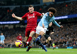 Liverpool's James Milner (left) and Manchester City's Leroy Sane (right) battle for the ball during the Premier League match at the Etihad Stadium, Manchester.