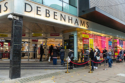 © Licensed to London News Pictures. 12/12/2020. London, UK. Shoppers queue outside Debenhams department store in Oxford Street on a busy Saturday afternoon. London is currently under Tier 2 Covid restrictions and could be facing Tier 3 as the Covid-19 case rate has been the highest in the UK. Photo credit: Ray Tang/LNP