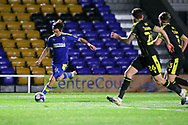 AFC Wimbledon midfielder Ethan Chislett (11) about to cross the ball during the EFL Sky Bet League 1 match between AFC Wimbledon and Bristol Rovers at Plough Lane, London, United Kingdom on 5 December 2020.