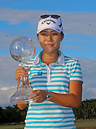 151122  Lydia Ko holds the $1,000,000 CME GlobeTrophy on the 18th green at the conclusion of Sunday's Final Round of The CME Group LPGA Tour Championship at The Tiburon Golf Club, in Naples, Fl.(photo credit : kenneth e. dennis/kendennisphoto.com)