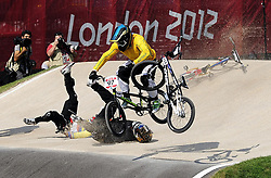 File photo dated 09-08-2012 of New Zealand's Kurt Pickard (black) and Ecuador's E.A Falla Buchely (yellow hat) crash as Australia's Khalen Young jumps over them in the Quarter Final of the BMX