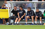 AFC Wimbledon manager Neal Ardley with hands over eyes during the EFL Sky Bet League 1 match between AFC Wimbledon and Scunthorpe United at the Cherry Red Records Stadium, Kingston, England on 15 September 2018.