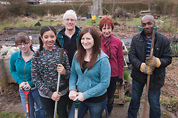 Portrait of gardening group on an allotment.