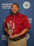 Target Group Vice-President for South Texas Dell McKinney poses with a Hall of Fame trophy following the Houston ISD Partnership Appreciation breakfast at Kingdom Builders, October 25, 2013.