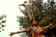 A family of acrobats practice their routine in Shadipur.Shadipur Depot, New Delhi, India<br /> The Kathiputli Colony in the Shadipur Depot slum is home to hundreds of (originally Rajasthani) performers. The artistes who live here - from magicians, acrobats, musicians, dancers and puppeteers are often international renowed by always return to the Shadipur slum.