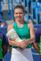 August 19, 2018 - Mason, Ohio, USA - Simona Halep (ROU) holds the runner up trophy for second place at Sunday's final round of the Western and Southern Open at the Lindner Family Tennis Center, Mason, Oh. (Credit Image: © Scott Stuart via ZUMA Wire)