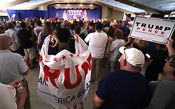 """A child draped in a """"Trump for President"""" banner makes an apt-for-Halloween view while waiting for Republican vice presidential candidate Mike Pence at a rally on Monday, Oct. 31, 2016 in Maitland, FL, USA. Photo by Joe Burbank/Orlando Sentinel/TNS/ABACAPRESS.COM"""