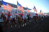American flags abound at Friday night's Grand Entry to the 102nd California Rodeo Salinas, which opened July 19 for a four-day run.