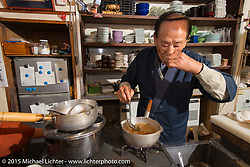 """Making the final dish in a 6-course dinner at Restaurant """"Tenryu"""" prepared by 82-year old Harley-Davidson riding Chef Ryutaro Nakamura, Japan. December 8, 2015.  Photography ©2015 Michael Lichter."""