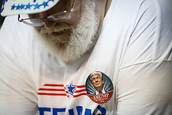 Feb. 12, 2016 - Tampa, Florida, U.S. - LOREN ELLIOTT   |   Times.Trump supporter Mitch Llewellyn of Spring Hill wears a button at a Donald Trump rally during the business mogul's presidential campaign at the University of South Florida Sun Dome in Tampa, Fla., on Friday, Feb. 12, 2016. Trump is leading Florida polls for the Republican nomination. (Credit Image: © Loren Elliott/Tampa Bay Times via ZUMA Wire)