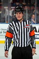 KELOWNA, BC - DECEMBER 18: Referee Matt Hicketts stands on the ice at the Kelowna Rockets against the Vancouver Giants  at Prospera Place on December 18, 2019 in Kelowna, Canada. (Photo by Marissa Baecker/Shoot the Breeze)