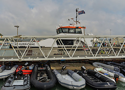© Licensed to London News Pictures. 20/09/2021. Dover, UK.  Small boats used by migrants to cross the English Channel are tied up next to Border Force Hurricane at Dover Harbour in Kent. Migrants are continuing to attempt the crossing from France as the weather improves this week. Photo credit: Stuart Brock/LNP