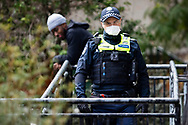 A frustrated police officer is seen walking away from an angry resident of 120 Racecourse Road Flemington amid a full and total lockdown of 9 housing commission high rise towers in North Melbourne and Flemington during COVID-19 on 5 July, 2020 in Melbourne, Australia. After 108 new cases where uncovered overnight, the Premier Daniel Andrews announced on July 4 that effective at midnight last night, two more suburbs have been added to the suburb by suburb lockdown being Flemington and North Melbourne. Further to that, nine high rise public housing buildings in these suburbs have been placed under hard lockdown for a minimum of five days, effective immediately.  Residents in these towers will not be allowed to leave their units for any reason. Police will be stationed at every entry and exit point, every level, and they will also surround these locations preventing any movement in, or out. There is a total of 1354 units and over 3000 residents living in these buildings including the states most vulnerable people. These new restrictions will remain in place for fourteen days with fears of further lockdowns to come. The Government have stressed that if Victorians do not follow the basic COVIDSafe rules, the whole state will go back in to lockdown. (Image by Dave Hewison/ Speed Media)