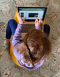 April 22, 2020, Racine, Wisconsin, USA: A third grade student does her daily class assignments as virtual learning on her Chromebook computer in Racine, Wisconsin, in April 2020. Educators are concerned about economic disparities in achievement because not all students have access to computers or robust Internet service. Wisconsin schools have been closed because of COVID-19. (Credit Image: © Mark Hertzberg/ZUMA Wire)