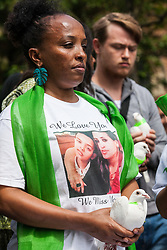 London, UK. 14th June, 2018. The sister of Brikti Haftom prepares to release a dove of peace outside St Helen's Church to mark the first anniversary of the Grenfell Tower Fire.