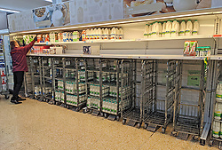 © Licensed to London News Pictures 20/09/2021. <br /> Sevenoaks, UK, Empty milk trolleys at Sainsburys in Sevenoaks, Kent today. Supermarket shortages are continuing across the UK due to a lack of supply and a shortage of lorry drivers which is expected to get a lot worse over the next few months. Photo credit:Grant Falvey/LNP