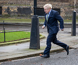 © Licensed to London News Pictures. 13/12/2019. London, UK. Prime Minister Boris Johnson arrives back at Downing Street after meeting the Queen at Buckingham Palace to ask her Majesty's permission to form a Government as the Conservative party celebrate a landslide victory in yesterday's December 12th 2019 General Election . Photo credit: Alex Lentati/LNP