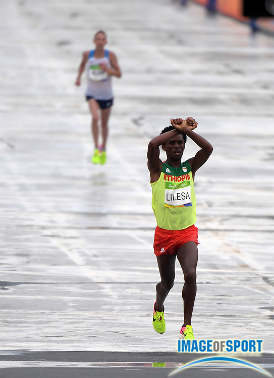Aug 21, 2016; Rio de Janeiro, Brazil; Feyisa Lilesa (ETH) places second in the marathon in 2:09:54 during the Rio 2016 Summer Olympic Games at Sambodromo.