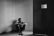 Silver gelatine of Peter Beard sitting in Van Gogh's cell, taken by Marella Oppenheim,  in 1984, in St Remy de Provence, France