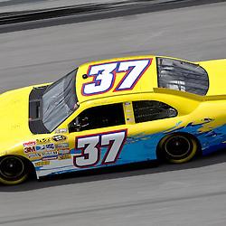 April 16, 2011; Talladega, AL, USA; NASCAR Sprint Cup Series driver Tony Raines (37) during qualifying for the Aarons 499 at Talladega Superspeedway.   Mandatory Credit: Derick E. Hingle