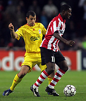 Photo: Paul Thomas.<br />PSV Eindhoven v Liverpool. UEFA Champions League, Quarter Final, 1st Leg. 03/04/2007.<br /><br />Javier Mascherano (L) of Liverpool battles Edison Mendez.
