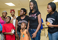 """Students listen as Young People's Project program coordinator Marquise Lowe (not pictured) gives directions for an """"icebreaker"""" activity Aug. 3, 2013, in Jackson, Miss. YPP was founded in 1996 and focuses on math literacy as a way to empower youth and help them overcome obstacles to their success. (Photo by Carmen K. Sisson/Cloudybright)"""