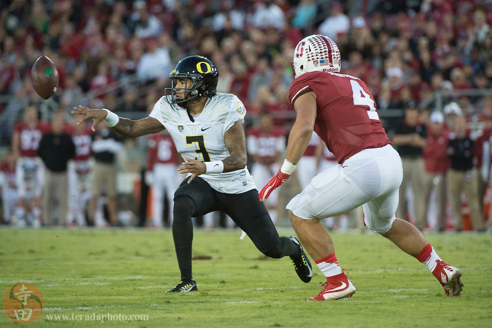 November 14, 2015; Stanford, CA, USA; Oregon Ducks quarterback Vernon Adams Jr. (3) passes the football against Stanford Cardinal linebacker Blake Martinez (4) during the first quarter at Stanford Stadium.