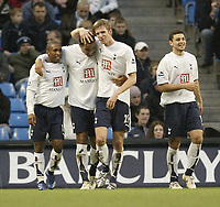 Photo: Aidan Ellis.<br /> Manchester City v Tottenham Hotspur. The Barclays Premiership. 17/12/2006.<br /> Spurs second goal scorer Tommy Huddlestone (c) is congratulated by first goal scorer Calum Davenprt (R) and Jermain Defoe