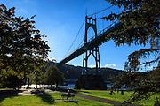 USA, Oregon, Portland, Cathedral Park, visitors enjoying the afternoon.