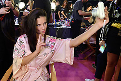 Adriana Lima backstage ahead of the Victoria's Secret Fashion Show at the Mercedes-Benz Arena in Shanghai, China.