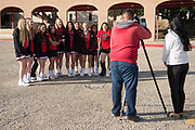 The Iraan High School cheerleading squad visits with the media before their trip to Arlington for the state championship football game in Iraan, Texas on December 14, 2016. (Cooper Neill for The New York Times)