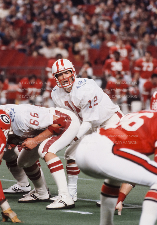 HOUSTON -  DECEMBER 31:  Quarterback Steve Dils #12 of the Stanford Cardinals plays in the Bluebonnet Bowl in a post-season game against Georgia at the Astrodome in Houston, Texas on December 31, 1978.   Stanford won the game 25-22.  Photo by David Madison