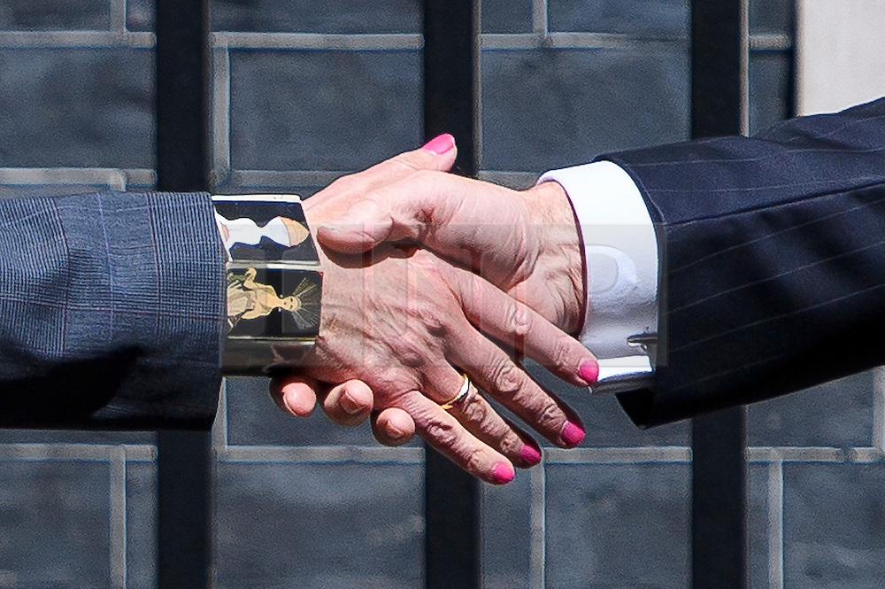 © Licensed to London News Pictures. 26/07/2016. London, UK. The hand of British prime minister THERESA MAY shakes the hand of Taoiseach ENDA KENNY outside Number 10 Downing Street. The pair are expected to discuss impact of Britain's recent vote for Brexit. Photo credit: Ben Cawthra/LNP
