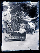 children playing with pull cart in the form of a automobile France 1920s