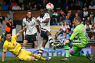 Moussa Dembele of Fulham © has his eyes on the ball as he takes a shot at goal but sees it saved by goalkeeper Cody Cropper of Milton Keynes Dons . Skybet football league championship match, Fulham  v Milton Keynes Dons at Craven Cottage in London on Saturday 2nd April 2016.<br /> pic by Steffan Bowen, Andrew Orchard sports photography.
