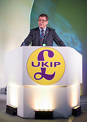 © Licensed to London News Pictures. 26/09/2014. Doncaster, UK. Mike Hookem MEP gives a speech on defence.  The UKIP conference at Doncaster Racecourse Friday 26th September 2014. Photo credit : Stephen Simpson/LNP