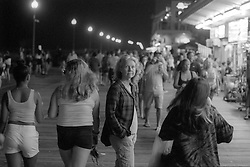 Kathleen Kirkwood of Oakland, Calif., center, pauses on the boardwalk in Rehoboth Beach, Del., Sunday, Aug. 18, 2019. (Photo by D. Ross Cameron)