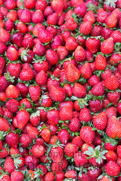 Fresh fruit strawberries on display for sale at food market in Kadikoy district on Asian side of Istanbul, East Turkey