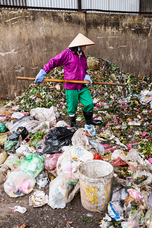 Workers sorting compostables from other rubbish at the compost plant of Cau Dien, a commune near Hanoi, Vietnam, Southeast Asia