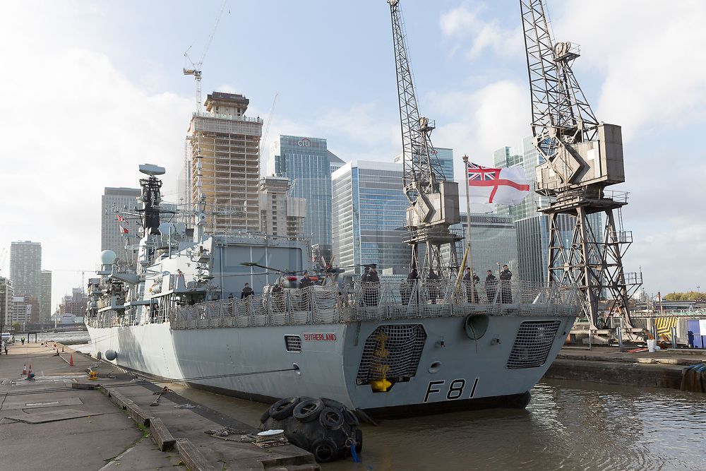 © Licensed to London News Pictures. 21/10/2017. LONDON, UK.  Royal Navy officers on baord HMS Sutherland, a Type 23 frigate of the British Royal Navy as she approaches West India Dock, Canary Wharf for Trafalgar Day celebrations. The ship is celebrating the 20th anniversary of her commissioning this year and will be visited by Her Majesty the Queen next week..  Photo credit: Vickie Flores/LNP